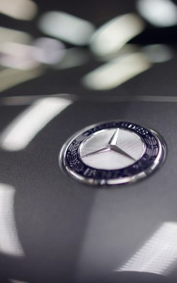 A company logo is seen on a Mercedes-Benz A-class car displayed in a dealership of German car manufacturer Daimler in Paris