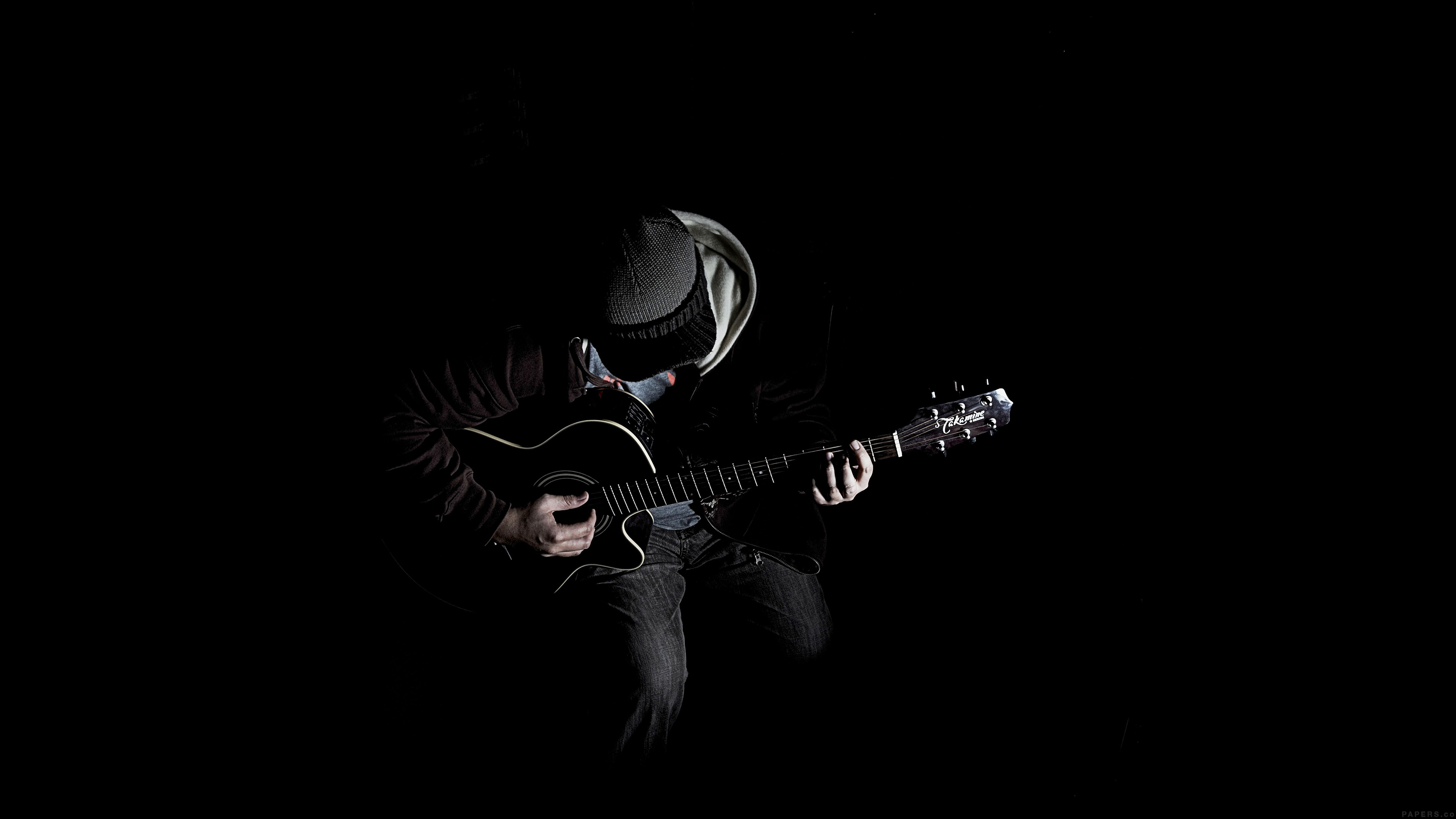 Al10-out-the-dark-guitar-player-music