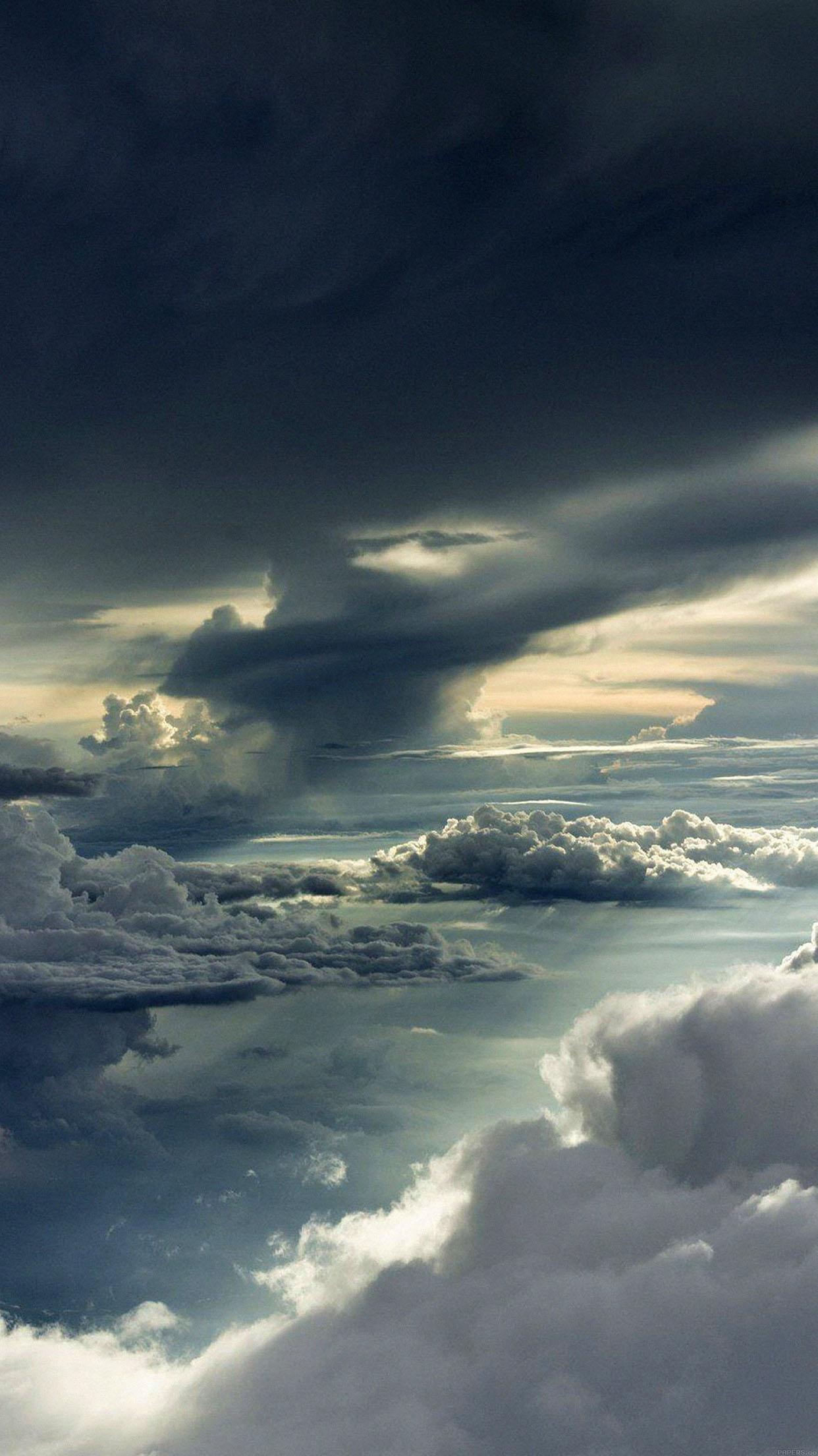 iphone7papers mc83 wallpaper between storm clouds sky