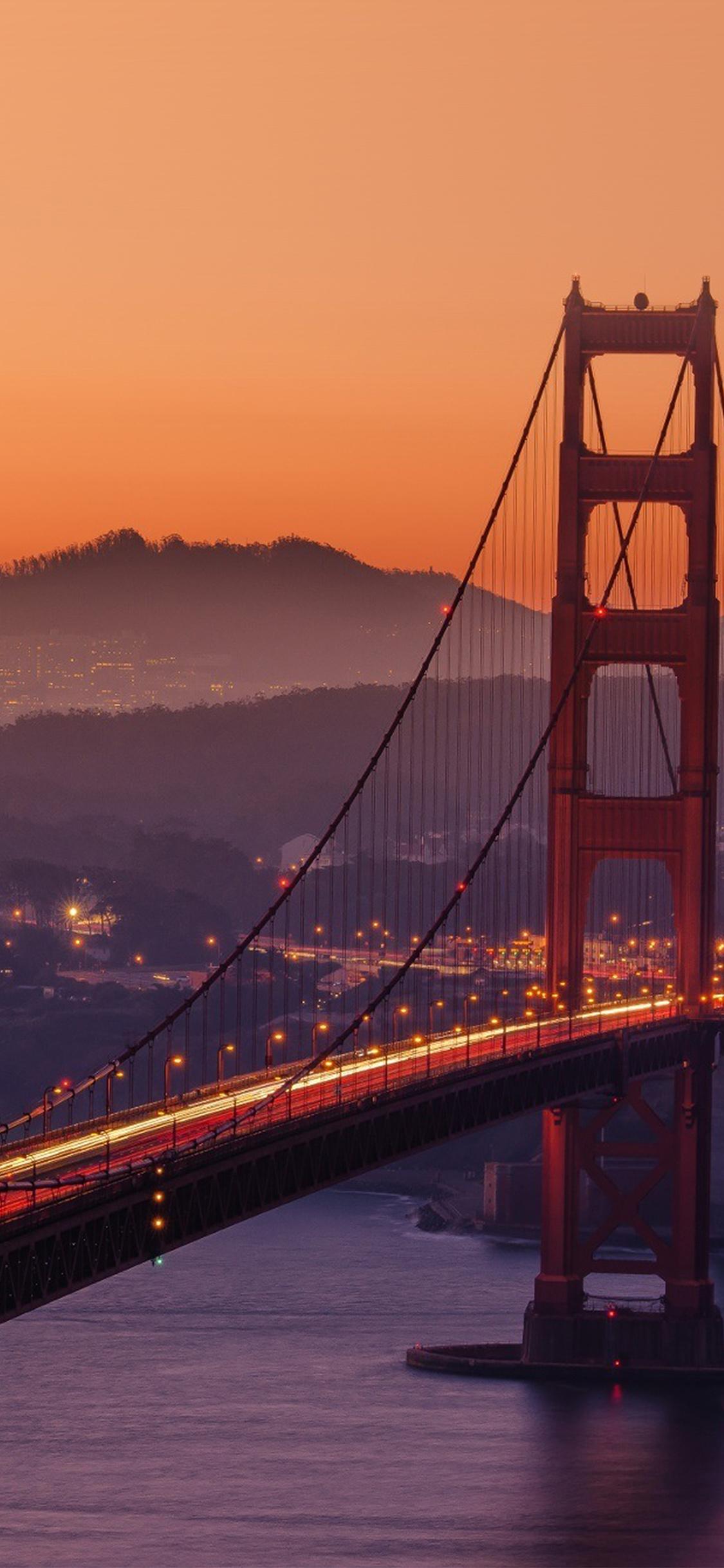 iPhoneXpapers.com-Apple-iPhone-wallpaper-ne10-bridge-orange-sunset-river-city-lights