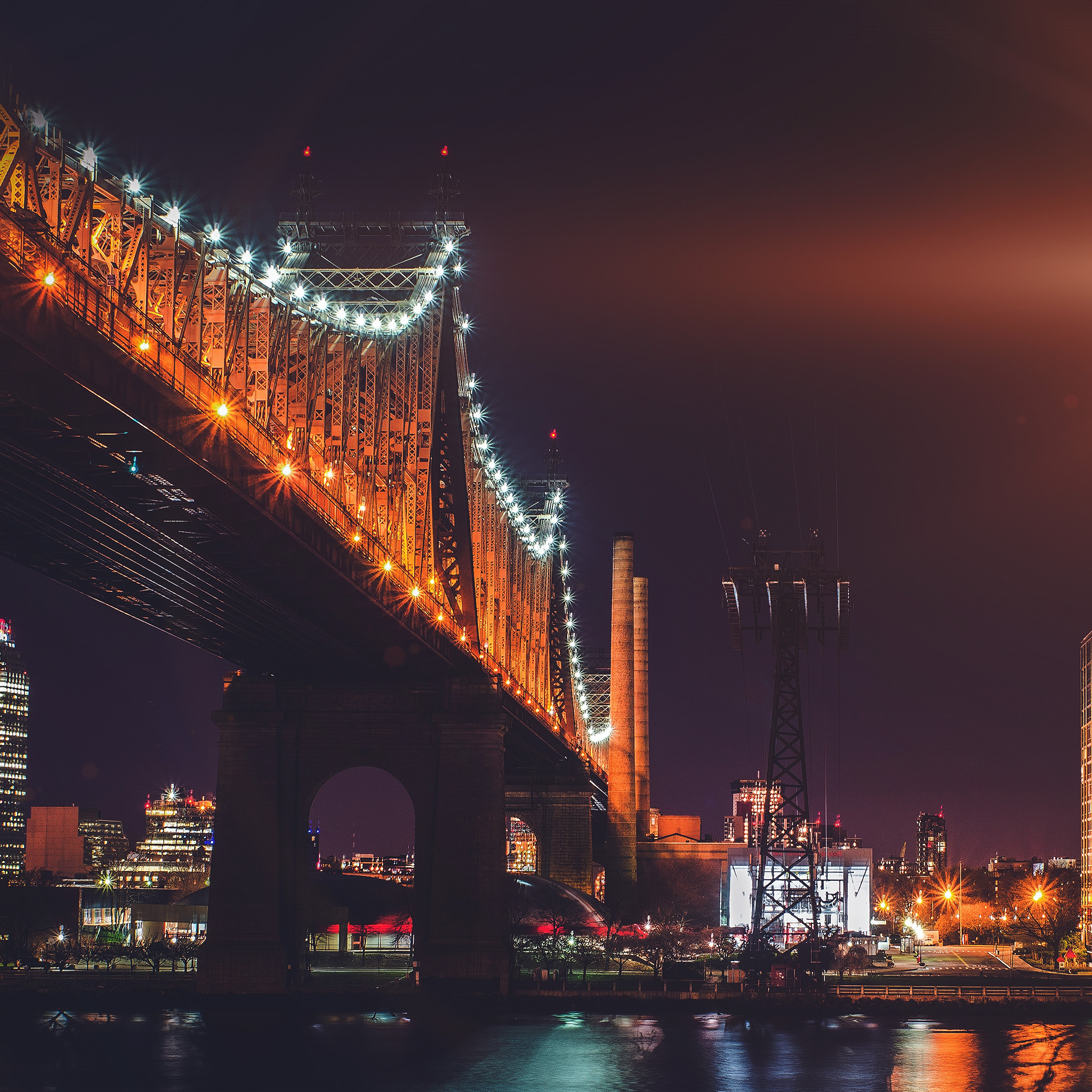 Nf75-bridge-night-river-city-lights-orange-flare-wallpaper