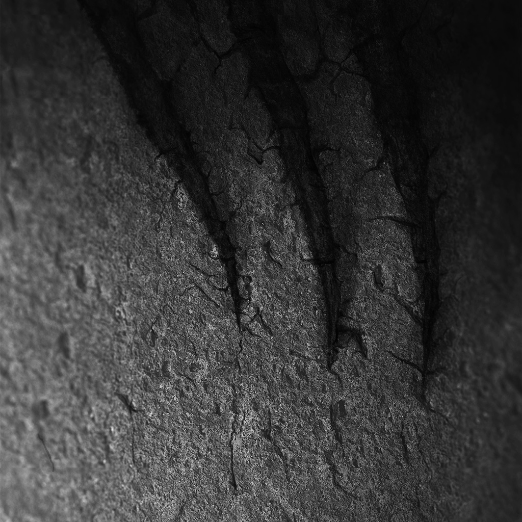 android-wallpaper-vu30-rock-dark-bw-pattern-texture-cut-black-wallpaper